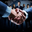 Handshake isolated on business background — Stock Photo #47949935