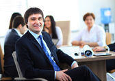 Portrait of smiling businessman working in office, looking camera — Stock Photo
