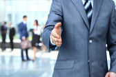 Businessman extending hand to shake — Stock Photo