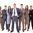 Confident business executive with his team in the background — Stock Photo #5350829