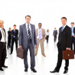 Business team formed of young businessmen standing over a white background — Stock Photo #5574843