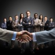 Handshake isolated on business background — Stock Photo #5658899