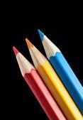 Three Pencils on Black Background — Stock Photo