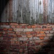 Spotlight on Dark Grungy Wall — Stock Photo #12836132