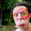 Indian Wearing Face Paint Showing His Tongue — Stock Photo