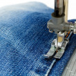 Foot of Sewing Machine on Jeans Fabric — Stock Photo #14008705