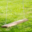 Empty Wooden Garden Swing - Stock Photo