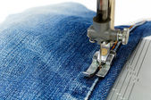 Foot of Sewing Machine on Jeans Fabric — Stock Photo