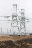 Transmission Towers in Industrial Area — Stock Photo