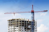 Tower Crane and Unfinished Building at Construction Site — Stock Photo