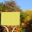 Blank Sign Plate on Bright Autumn Tree Background — Stock Photo