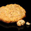 Oatmeal Cookie with Crumbs on Black Background — Stock Photo