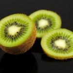 Kiwi Fruit Slices on Black Background — Stock Photo