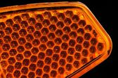 Orange Retroreflector Macro on Black Background — Stock Photo