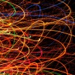 Abstract Bright Multicolored Glowing Lines and Curves on Black Background — Stock Photo #47002375