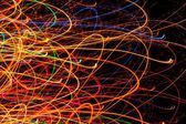 Abstract Bright Multicolored Glowing Lines and Curves on Black Background — Stock Photo