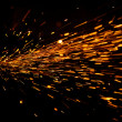 Glowing Flow of Sparks in the Dark — Stock Photo #47634889