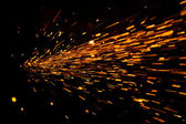 Glowing Flow of Sparks in the Dark — Stock Photo