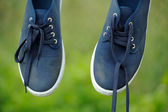 Dirty Blue Sneakers on Clothes Line — Stock Photo