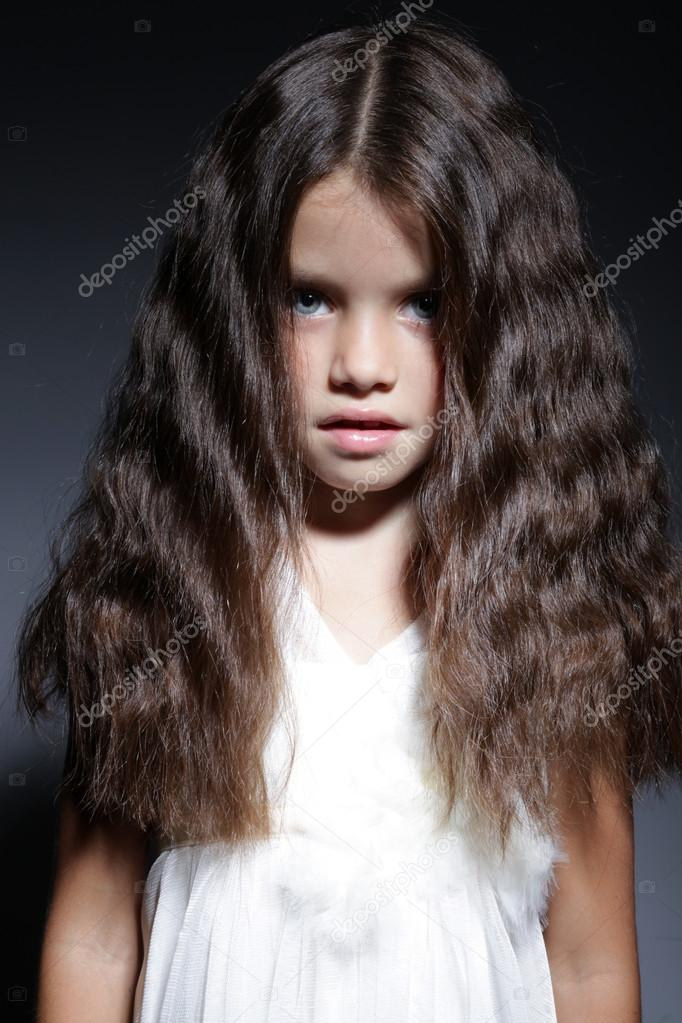 Amazing Portrait Of Young Beautiful Little Girl With Dark Hair Stock Short Hairstyles For Black Women Fulllsitofus