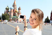 Woman photographed attractions in Moscow — Stock Photo