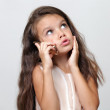 Little girl calling by phone — Stock Photo
