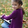 Little Girl holding tablet digital computer — Stock Photo
