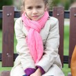 Portrait of a beautiful girl in a pink scarf — Stock Photo