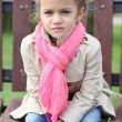Stock Photo: Portrait of beautiful girl in pink scarf