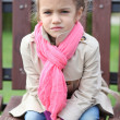 Portrait of a beautiful girl in a pink scarf - Stock Photo