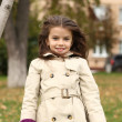 Little girl in the autumn park — Stock Photo