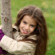 Stock Photo: Little girl in the autumn park