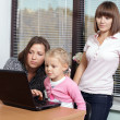 Stock Photo: Two women with young daughters