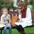 Mother with little girl in autumn park — Stock Photo
