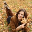 Woman calling by phone in autumn park  — Stock Photo