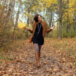 Walking woman in autumn park — Stock Photo #13518554