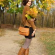 Stock Photo: Walking woman in autumn park