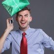Portrait of young business man with gift — Stock Photo #13543531