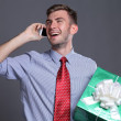Portrait of young business man with gift — Stock Photo