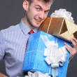 Portrait of young business man with gifts — Stock Photo