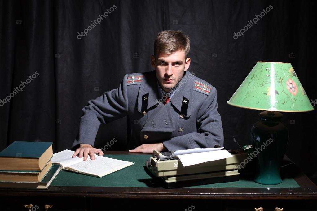 Russian military officer in a dark cabinet  Stock Photo #13543678