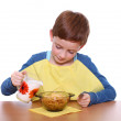 Little boy breakfast isolated over white background — Stock Photo