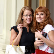 Two happy women with shopping in a store — Stock Photo