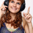 Happy young woman listening to music — Stock Photo #14258807