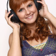 Happy young woman listening to music - Foto de Stock
