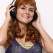 Happy young woman listening to music  — Stock Photo