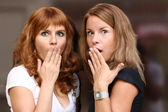 Two young beautiful women are very surprised — Stock Photo