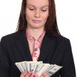 Royalty-Free Stock Photo: Young woman holding a 100 dollar bill