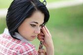Closeup portret van een jonge vrouw op zoek depressief — Stockfoto