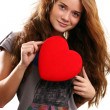Young woman holding a heart — Stock Photo #15853369